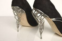 Shape: These heels use curvilinear lines to achieve this  swirling cage construction. The lines reference Art Nouveau.
