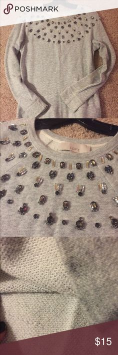 LOFT Jeweled shoulder sweat shirt. This is a soft comfortable sweatshirt.. However.... It's beautiful and ready for a party, a work day or a night out.. It's the best of both worlds.. All jewels are securely attached (no need to dry clean) it is in great condition.. It's in great shape and a classic upscale brand. Any questions just ask! LOFT Tops