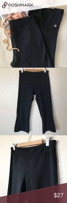 "Lululemon Crop Workout Pant Capri style workout pant with open detail at calf. Cropped at knee for ultimate comfort during workout. Features iconic lulumon internal drawstring at waist and yoga pocket. (Measurements: Waist 13.5"" Inseam 21.5"")  Good used condition.  No Trades, Offers Welcome, and No Modeling!  Same Day shipping before 3pm (Mon- Fri) Noon on Saturday (PST) lululemon athletica Pants Ankle & Cropped"