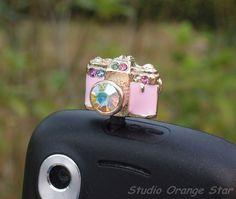 1PC Bling Rhinestone Cute Camera Earphone Charm Cap Anti Dust Plug for iPhone 5, iPhone 4, Samsung S3. $4.99, via Etsy.