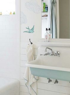 Turquoise blue bathroom features upper walls clad in Hygge & West Daydream French BLue Wallpaper and lower walls clad in shiplap lined with a turquoise blue trough sink, Kohler Brockway Sink, fitted with two faucets and a full length mirror. Bathroom Kids, Bathroom Renos, Small Bathroom, Trough Sink Bathroom, Kids Bath, Kids Sink, Bird Bathroom, Paint Bathroom, Bathroom Canvas
