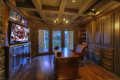 Traditional Home Office with Pendant Light, Built-in bookshelf, Laredo Pedestal Desk, Hardwood floors, Box ceiling
