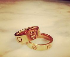 Cartier love rings. Love the thinner wedding band with the classic style.