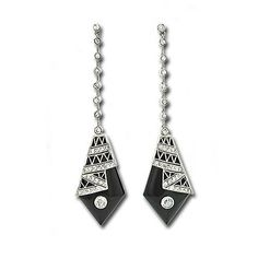 Art Deco onyx earrings. Glamorous black and white ultimate original Deco drop earrings featuring a slim line of bezel set diamonds swinging a diamond shaped panel of onyx decorated with a fine linen fold design glimmering with diamonds (1.30 carats total weight, H-J color, VS-I1 clarity). These earrings measure 2 3/8 long by 5/8 wide.