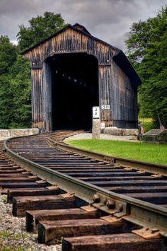 tracks into a covered bridge
