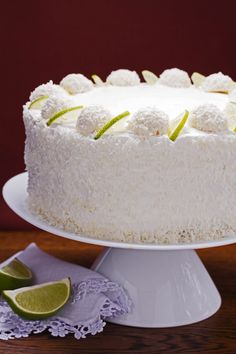 Recipe including course(s): Dessert; and ingredients: baking powder, baking soda, butter, coconut, coconut milk, coconut oil, cream cheese, egg, flour, limes, powdered sugar, salt, shortening, sour cream, sugar, vanilla extract
