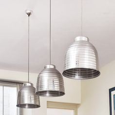 Large-scale aluminum pendant lights can tie your kitchen's stainless appliances and hardware together. Similar to shown: 20-inch Foto Pendant Lamp, from IKEA. | Photo: Colin Poole/IPC Images | thisoldhouse.com