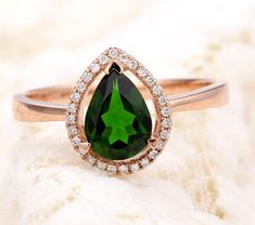 Pear shaped emerald engagement rings