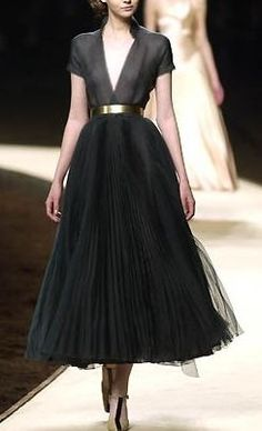 Oldfashioned vintage style classic Chanel. Black plissé chiffon dress, low cut out V neckline.