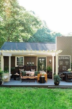 Keep score — or just keep it cozy — on this stunner of a back porch. | 11 Backyard Renovations That Will Make You Want To Buy The House