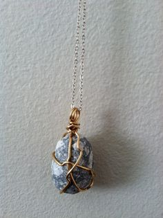 Earthy rocks and pendants on pinterest speckled rock pendant with gold wire by maynard artwork on etsy pendant etsy aloadofball Gallery