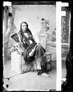 Oglala Portrait of Chief Red Shirt in Partial Native Dress and with Fur -Wrapped Braids and Feather Fan 1879