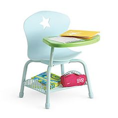 School Desk Set for Dolls  Item# G0022  When the bell rings, her American Girl doll can take a seat in this school desk. It features:    A sky-blue chair with a star cutout, a green desktop, and a storage rack to hold her supplies  A doll-sized math book and a pencil case   A homework project inside a yellow folder for her doll  $42