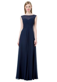 Chiffon sleeveless gown with a sheer illusion top and a sweetheart neckline.  Criss-cross pleats accent the bodice with a V-back.  Inverted front and back center pleats.