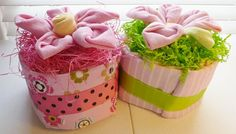 Diaper Cake with Large Flower (Pink for Girl or Blue for Boy)-   12 disposable diapers (size 2)  7 infant washcloths used for the large flower  1 flannel receiving blanket (size 36x36 inches)  Ribbons, and shredded paper
