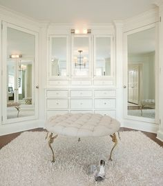 all-white dressing room with ottoman