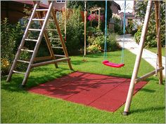 i like the simplicity and potential of this swing set, the spongy tiles and pathway behind.