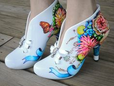 painted canvas shoes- i like the idea of a plainer front and floral design at the heel