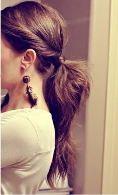 love this simple take on a low pony with side twist and wrapped band with hair