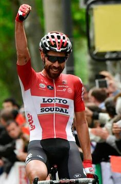 Belgium's Thomas De Gendt celebrates as he crosses the finish line at the end of the 1705 km first stage of the 69th edition of the Criterium du...