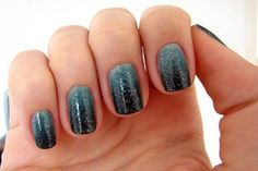 Black and dark green Ombre nail art design with glitters. When dark colors are used as Ombre it's usually a good idea to lighten up the combination with silver glitter polish.