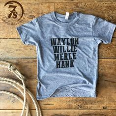 "The Legends {kids tee} - ""Waylon Willie Merle Hank"" kids graphic t-shirt. Black western graphics. Super soft heather gray. Perfect for any little cowboy or cowgirl."