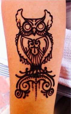 This owl henna tattoo would look good on a calf