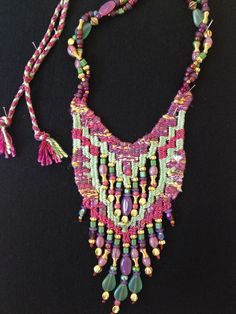 A beaded necklace by Helen Banes.