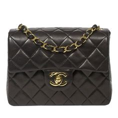Chanel Mini Flap Bag 18cm in black quilted lambskin | From a collection of rare vintage shoulder bags at https://www.1stdibs.com/fashion/handbags-purses-bags/shoulder-bags/
