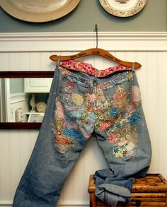 a mother's jeans patched with pieces of her children's handmade clothes.