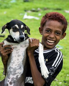 This is Ricky a Kupang's boy. He has 3 pet dogs and he loves playing with them.    Ricky always put on a brave smiling face despite all hardships. He stays in a poor community just beside the hotel that I stayed.     Learn about puppy training