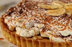 A Banoffee Pie has a buttery crisp shortbread crust, toffee, slices of sweet bananas, all covered with loads of whipped cream. From Joyofbaking.com With Demo Video