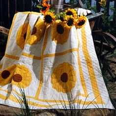 """Sunflower Quilt Quilting ePattern - Number of Designs: 1 quiltApproximate Design Size: 70-1/2"""" x 89-1/2""""Designer: Leisure Arts StaffOriginal Publication: Make Every Day Special magazine, August 1994 issueSkill Level: Intermediate†Description: Reminiscent of sunny sunflowers, this bright Dresden Plate quilt will bring the fresh beauty of a summer garden into your home. The quilt in our photo is an antique, but we've made it simple for you to re-create with our easy-to-follow instructions. ..."""