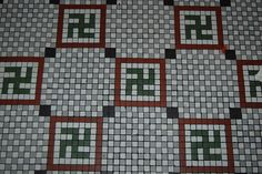 floor design at ernst cafe new orleans est. 1902 (before this symbol was associated w/ nazis)