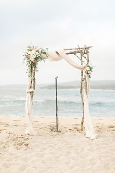 wedding arch with fabric draping + floral for beach wedding| fabmood.com #weddingarch #weddingarbor #fabricdraping #ceremonydecor #beachwedding