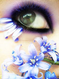 Flower petals on the eyes - how amazing!  Not sure how safe this is, but this page still has some super cool makeup ideas for festivals....25 Creative Uses of Cosmetics
