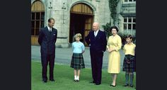 Britain's Queen Elizabeth II stands in the grounds of Balmoral Castle, Scotland, with U.S. President Eisenhower, Aug. 29, 1959. From left to right, Prince Philip, Princess Anne, President Eisenhower, Queen Elizabeth II and Prince Charles. (AP Photo).