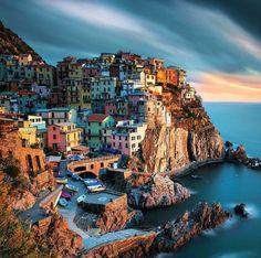 Manarola, Italy. Manarola is a small town, a frazione of the comune of Riomaggiore, in the province of La Spezia, Liguria, northern Italy. It is the second smallest of the famous Cinque Terre towns...
