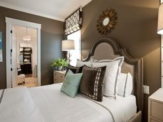 A cozy retreat defined by a color palette of chocolate brown and pale blue, the master bedroom showcases traditional style with a modern twist.