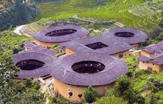 Hakka Roundhouses are the most beautiful and unique examples of Hakka architecture. The yellow color of their earthen walls harmonizes with the green rice terraces in the distance. (Image courtesy of Xiao Yue) - See more at: http://www.visiontimes.com/2013/11/12/amazing-chinese-architecture-hakka-roundhouses-photos.html