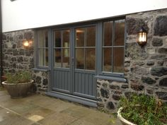 French Doors with side windows installed into te traditional stone in the Cornwall Cottage.