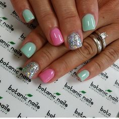 Pink and green nails with glitter nail