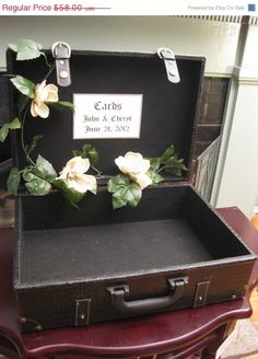 Guest book box - flower garland and a small sign outlining the guest book rules!
