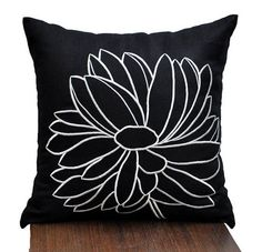 This pillow cover made from black linen fabric and embroidered with pretty flower design in white.  This pillow cover has hidden zipper and it is