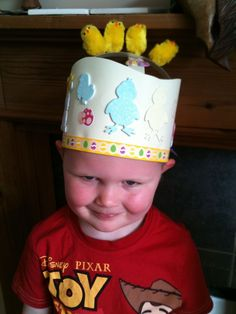 Easter hat with chicks on top.