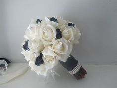 Real Touch Bridal Bouquet - Ivory Roses and Navy Forget-Me-Nots. $145.00, via Etsy.