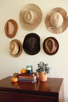 "Try This: hats as a temporary & seasonal ""gallery wall"""