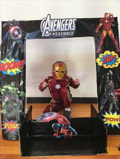 Avenger party idea- photo booth made of card boards and covered with avenger characters