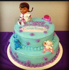 Doc Mcstuffins cake....I like the teal and purple
