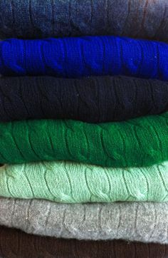 Cable knit sweaters in winter colors.